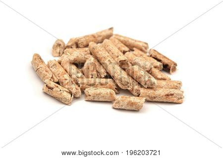 a heap of wood pellets isolated on white background