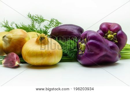 Assortment of fresh raw vegetables isolated on white background. Selection includes potato green onion pepper garlic and dill