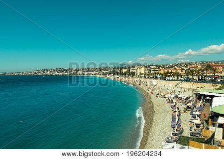 Crowded Mediterranean summer beach in City of Nice France
