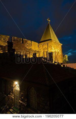 Church tower inside Kalemegdan fortress walls at night in Belgrade, Serbia