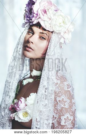 Portrait of a beautiful sensual bride with flowers in her hair