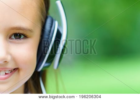 Copy Space And Hulf Face Of Young Attractive Caucasian Girl Listening Music With Professional Dj Hea