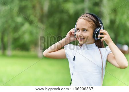 Young Girl Listening Music With Professional Dj Headphones
