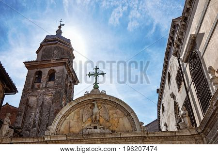 Close-up of carved marble portal of church and glow from the sun behind the bell tower. At the city center of Venice, the historic and amazing marine city. Located in Veneto region, northern Italy