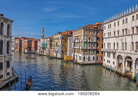 Venice, Italy - May 09, 2013. Overview of buildings, piers and gondolas in front of the Canal Grande. At the city center of Venice, the historic and amazing marine city. Veneto region, northern Italy