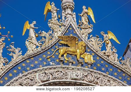 Close-up of sculptures and frontispiece made in marble and gold on the San Marco Basilica. At the city of Venice, the historic and amazing marine city. Located in Veneto region, northern Italy