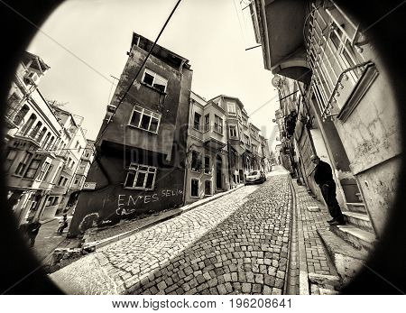 ISTANBUL TURKEY - APRIL 29 2017: Traditional stone street and houses at Fener district at Balat area. Balat is popular attraction in Istanbul.