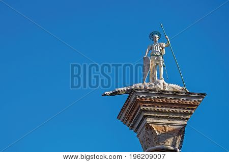 Close-up of St. Theodore's Column in St. Mark's Square with blue sunny sky. At the city of Venice, the historic and amazing marine city. Located in Veneto region, northern Italy