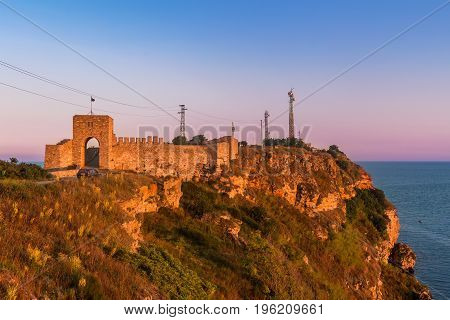 Fortress on cape Kaliakra in sunset time with golden red light on black sea coast Bulgaria.