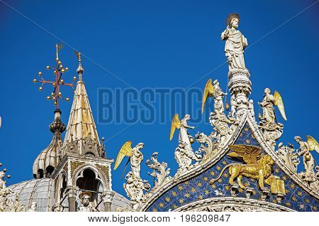 Overview of sculptures and frontispiece made in marble and gold on the San Marco Basilica. At the city of Venice, the historic and amazing marine city. Located in Veneto region, northern Italy