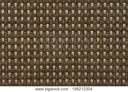 The texture of the carpet with a pile of brown
