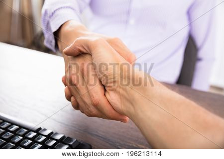 Close-up Of A Businessman Shaking Hands With His Partner
