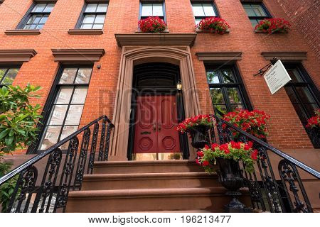 New York NY USA -- July 12 2017 -- Stairwell to the front door of a townhouse for sale in New York's Greenwich Village. Editorial Use Only.