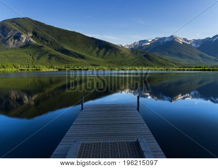 Wooden Pier overlooking the Rocky Mountains, Reflecting on Vermilion Lakes