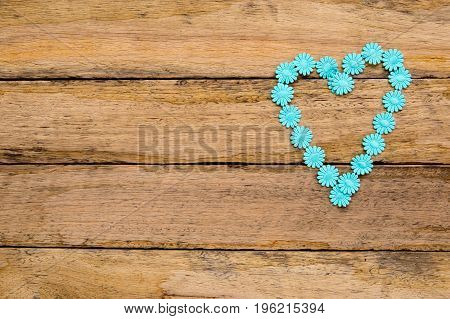 Blue Cotton Daisy Ribbon In Heart Shape On Wooden Background