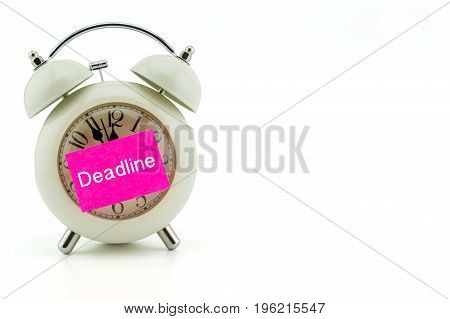 paper with Deadline text stick on clock in white background