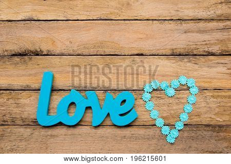 Love - Blue Turquoise Wooden Word With Heart Shape Daisy Ribbon On Wooden Background