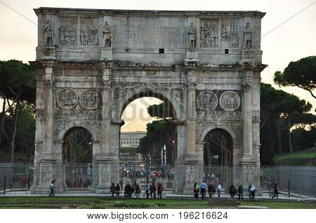 Rome Italy,November 5th 2010.Tourists admire the Arch of Constantine dedicated to Emperor Constantine who legalized Christianity.A true Rome delight.