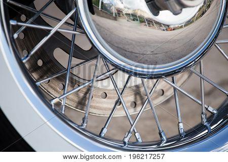 Wheel on a sport motobike as a background