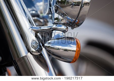 Headlight on a sport motobike as a detail