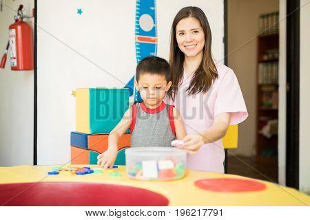 Happy Children Therapist At Work
