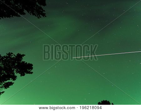 Green Northern Lights Aurora with the International Space Station Passing Overhead