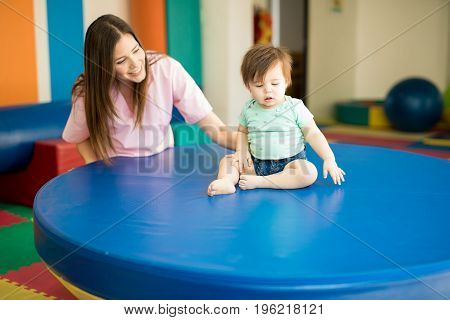 Therapist Helping A Baby Practice Balance
