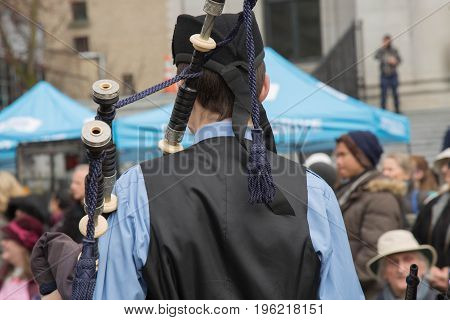 Irish musician playing bagpipe close up street concept