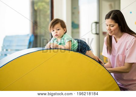 Baby Exercising And Climbing
