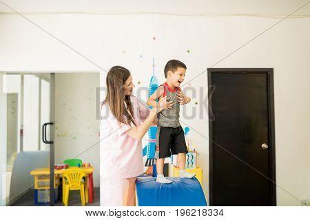 Little Boy Having Fun In Therapy