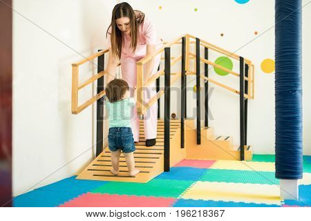 Therapist Helping Baby To Walk