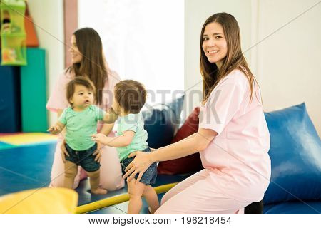 Therapist And Baby In Front Of A Mirror