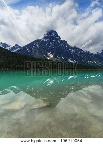 Tranquil Turquoise Waterfowl Lake with Mountain Reflection, Alberta, Canada