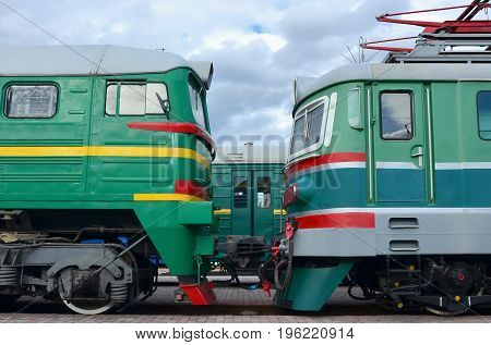 Cabs Of Modern Russian Electric Trains. Side View Of The Heads Of Railway Trains With A Lot Of Wheel