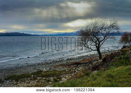 Stones on the coast of Lake Nahuel Huapi in the city of Bariloche