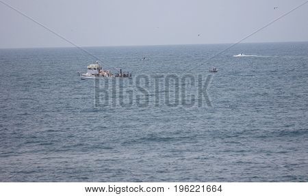 LA JOLLA, CALIFORNIA/USA - JULY 15, 2017:  Group of people fishing on a tourist boat off the shore of La Jolla, California