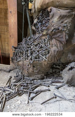 Bags Of Rusting Bolts In Attic