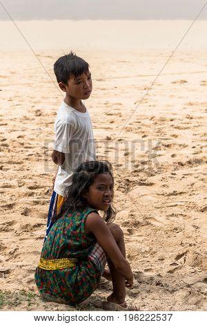 EL NIDO PALAWAN PHILIPPINES - JANUARY 20 2017: Focus on standing filipino boy at Nacpan Beach Philippines.