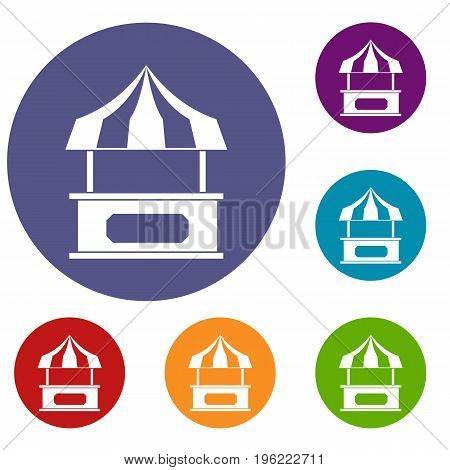 Store kiosk with striped awning icons set in flat circle red, blue and green color for web