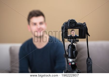 Close-up Of A Male Blogger Recording Video With Camera