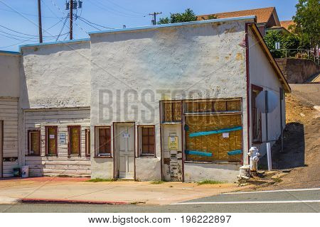 Boarded Up Store Front In Need Of Repair