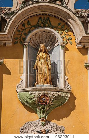View of golden sculpture in niche of church facade of Vence, a stunning medieval hamlet completely preserved. Located in the Alpes-Maritimes department, Provence region, southeastern France