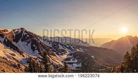 Panorama of a summer sunset in the Mountains at Snowbird Ski and Summer Resort Little Cottonwood Canyon Utah.
