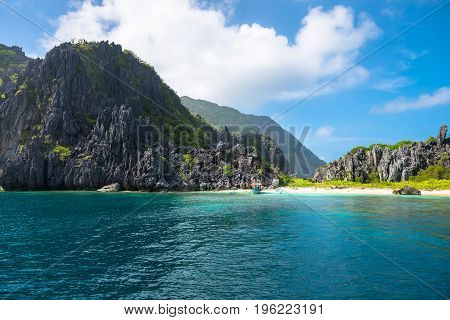 EL NIDO PALAWAN PHILIPPINES - JANUARY 19 2017: Huge sharp rocks beautiful beach and tropical weather in El Nido