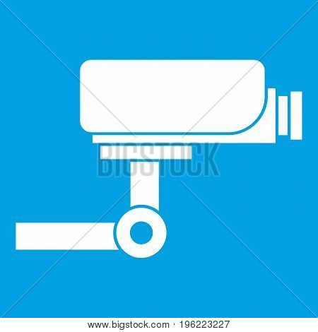 CCTV camera icon white isolated on blue background vector illustration