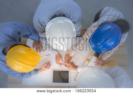 Engineering team is meeting, planning construction work, overhead view. Concept for team work - Stock image Business Meeting, Meeting, Working, Thailand, Above