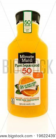 Winneconne WI - 20 July 2017: A bottle of Minute Maid pure squeezed 50 calories orange juice on an isolated background.