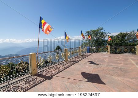 Colourful Buddhist Prayer flags are waving in strong wind under sunshine at Samdruptse huge buddhist memorial Monastery in Sikkim India.