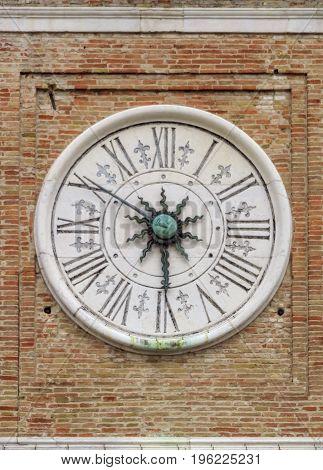 Ancient astronomical clock on the square Piazza tre Martiri in Rimini Italy