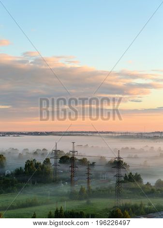 Landscape with a morning mist at dawn